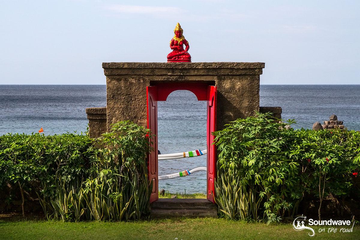 Smiling Buddha stone gate in Bali