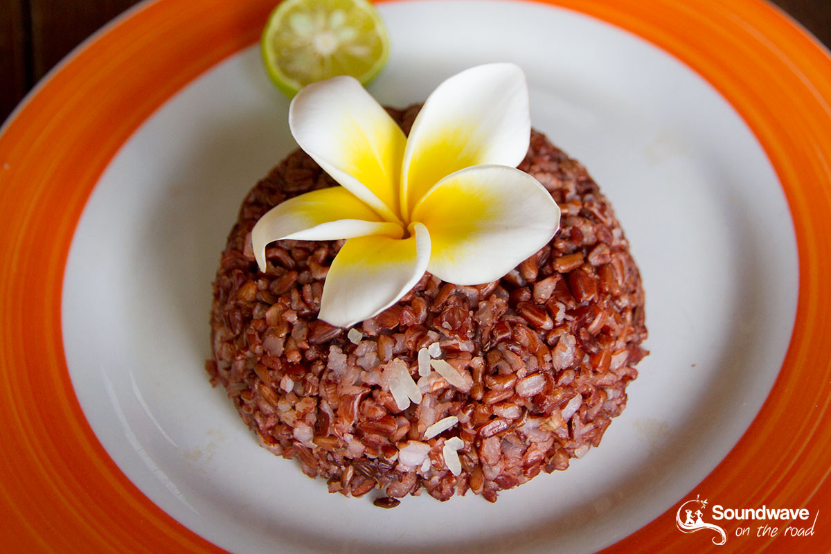 Red rice and frangipani flower